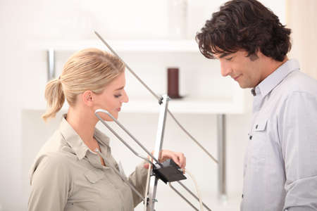 terrestrial: Couple installing television aerial