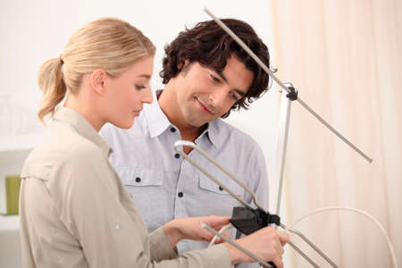 Couple setting up an antenna photo