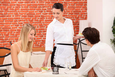 occasion: couple and waitress at restaurant
