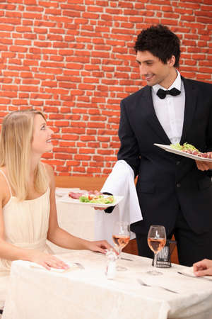 first love: Waiter serving lunch