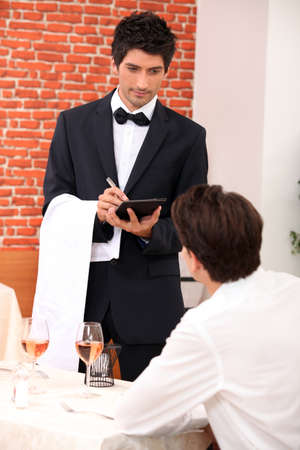 alcohol server: a waiter working at restaurant