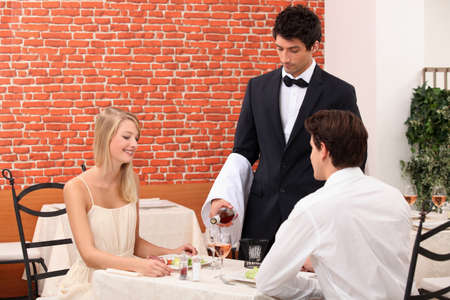 waiter serving couple photo