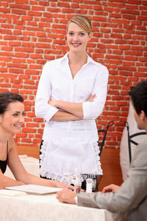 Waitress in a restaurant photo
