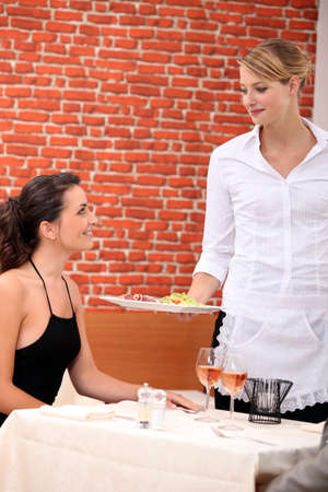 caf: Woman in a restaurant