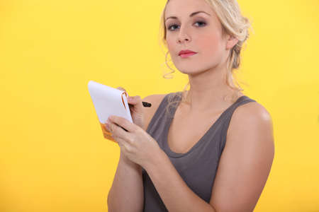 portrait of a woman with shopping list Stock Photo - 13839540