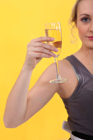 moderation: Woman holding glass of champagne