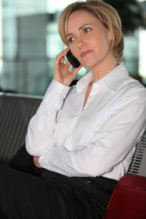Businesswoman on mobile phone photo