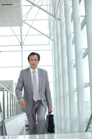 Businessman on escalator Stock Photo - 13839158
