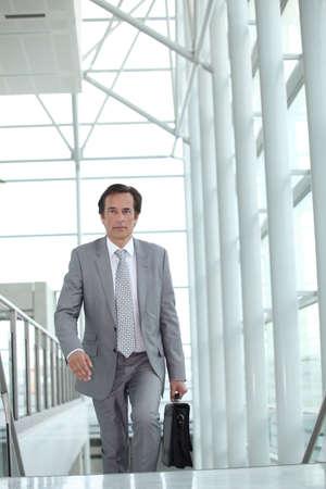 Businessman on escalator Stock Photo - 13839158