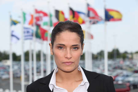 Brunette stood in front of flags photo