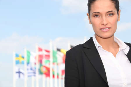 representations: Executive Woman in front of flags Stock Photo