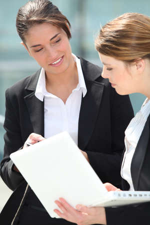 auditors: Two female colleagues discussing work