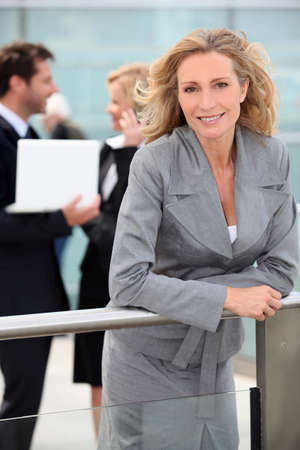 collaborators: Smiling woman outside office building