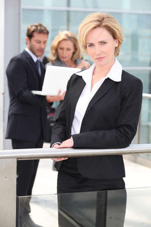 collaborators: Serious executives outside office building Stock Photo