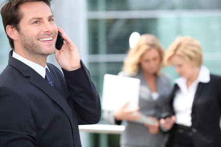 Man speaking in front of two women Stock Photo - 13841672