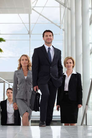 business people walking: Small group of executives