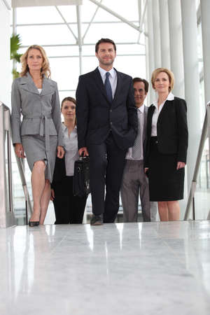 Group of executives climbing stairs photo
