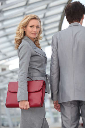 collaborators: Woman carrying briefcase with colleague Stock Photo