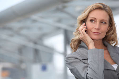 Businesswoman on mobile phone Stock Photo - 13839907