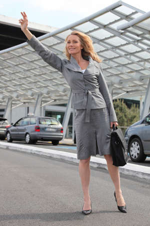 stopping: Businesswoman waving taxi