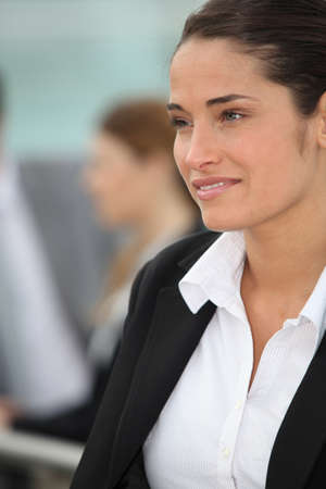 professionalism: Woman in suit Stock Photo