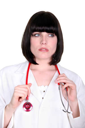 Pensive doctor with a stethoscope photo