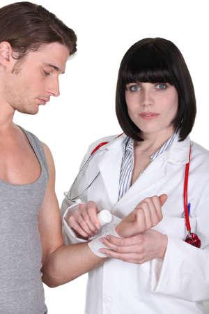 blood sport: Doctor bandaging a wrist