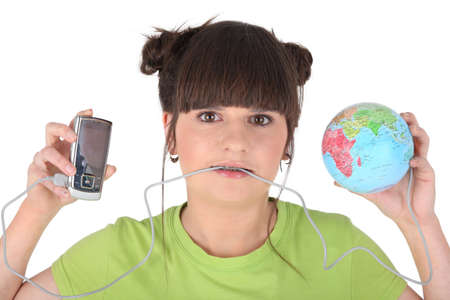 Brunette holding mp3 player and miniature globe photo