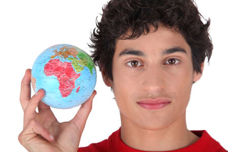 Young man holding a globe photo