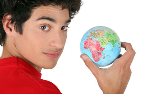 hectic life: dark-haired boy holding globe