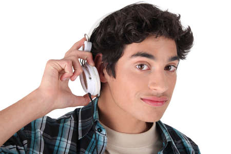 Young man listening to music Stock Photo - 13841935