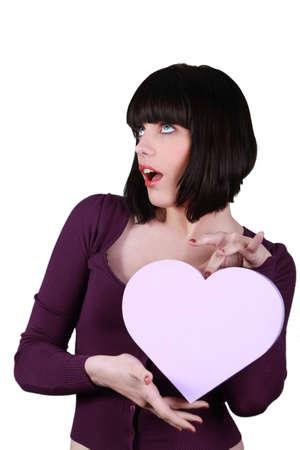 ravishing: woman holding a plastic heart Stock Photo