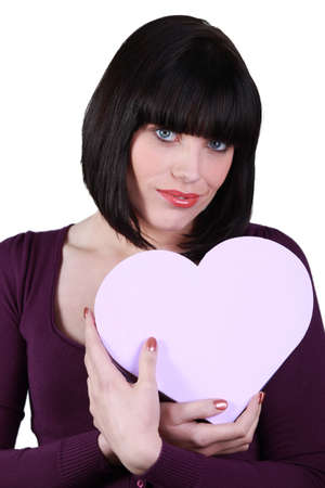 a brunette woman with a heart shaped box photo