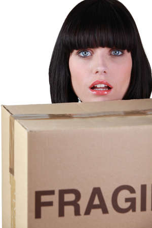 front raise: Young woman with moving cardboard