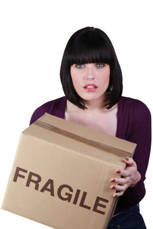 Woman carrying a heavy box photo