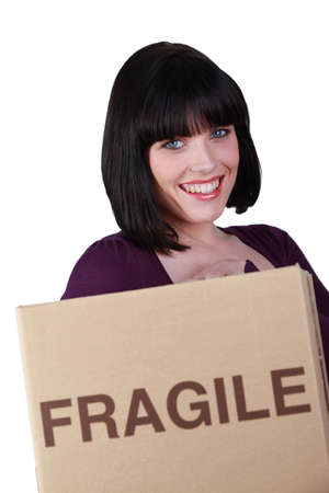 Woman with a box marked fragile Stock Photo - 13844147