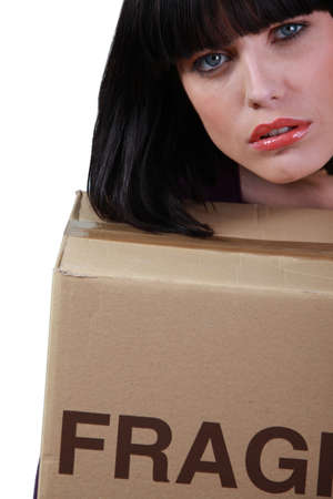 slumped: brunette slumped on removal box