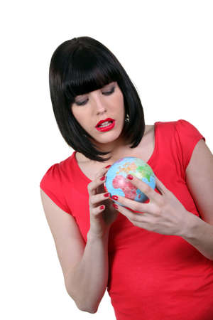 Woman holding a small globe photo