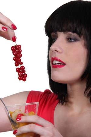 Woman eating fruit Stock Photo - 13844349