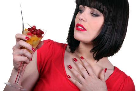 relishing: Woman relishing fruit cup Stock Photo