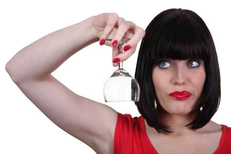 Woman with an empty wine glass photo
