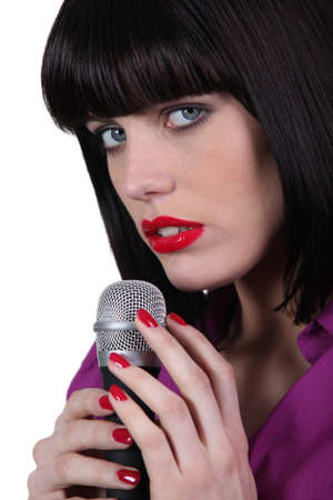 singular: female singer caressing a micro