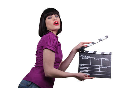 clapper board: Woman holding up a clapperboard Stock Photo
