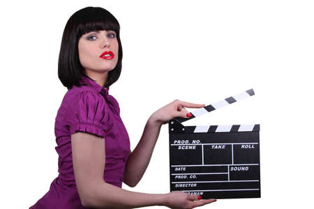 sexy pictures: Sexy woman with cinema clap, studio shot Stock Photo