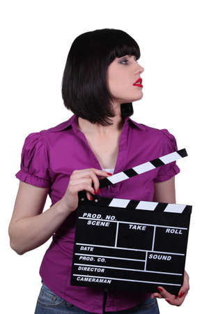 Attractive woman with a clapperboard Stock Photo - 13844353