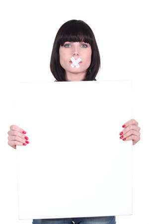 silently: Woman silently holding message board