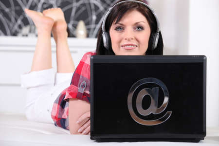 Woman with computer on the bed photo