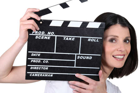 clapper board: Young woman with a film clapperboard