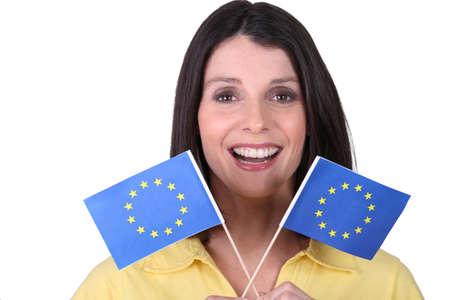 brandishing: brunette  brandishing European flags