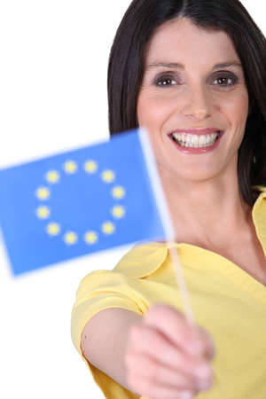 unification: Smiling woman holding an EU flag